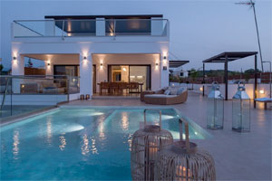 Modern villa with private tennis court walking distance to the beach