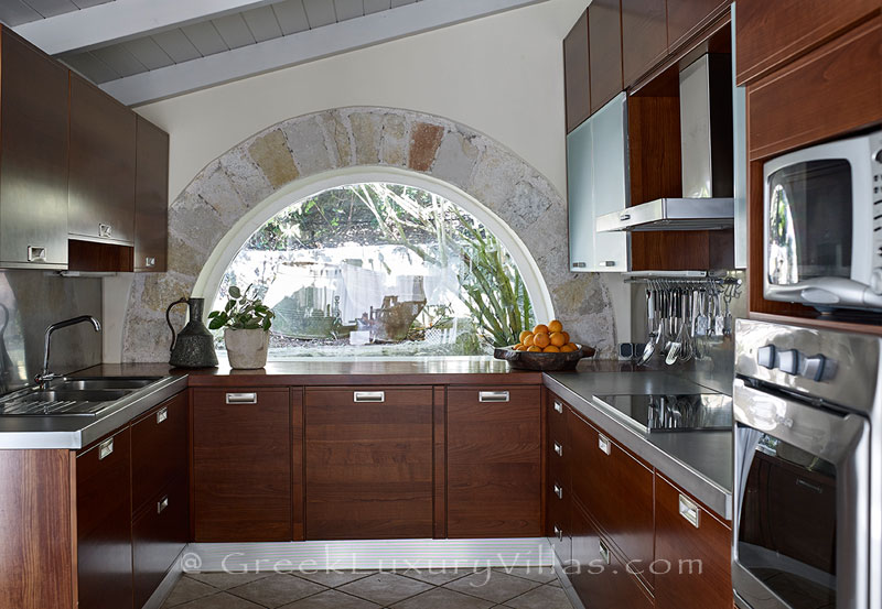 The kitchen of a luxury villa with a heated pool in Sivota