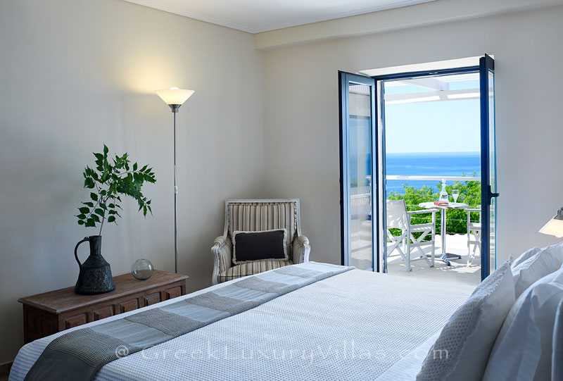 A bedroom in the luxury villa with a heated pool in Sivota