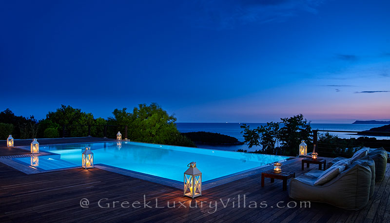 The luxury villa with a heated pool in Sivota at night
