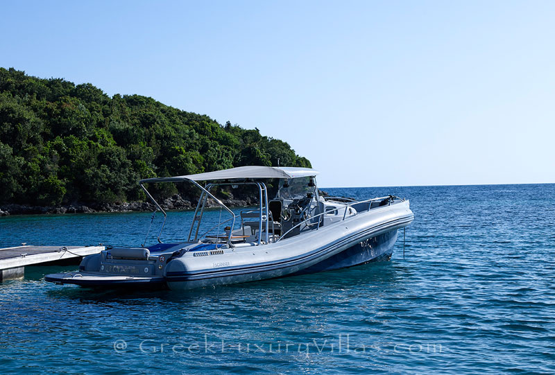 Speed boat of the luxury villa with a heated pool in Sivota
