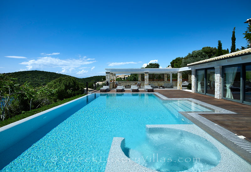 The heated pool and the jacuzzi of a luxury villa in Sivota